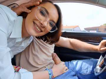Innocent-looking college girl Natalie Porkman blows huge cock in the car