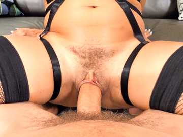 Busty brunette Kataljna Kittin in sexy outfit uses a guy's cock to her pleasure