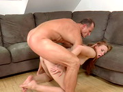Auburn-haired Linda Sweet shows off her pale, all-natural body in a mini-dress and heels. As ...
