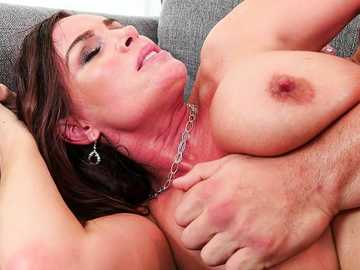 Sexy mom Diamond Foxxx seduces a young guy with her way too huge tits.