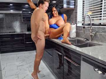 Busty bitch in rubber gloves Sybil Stallone rides younger dick in the kitchen