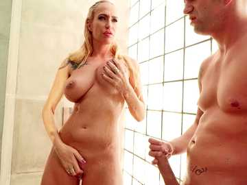 Busty MILF Sophie Evans takes big cock up shaved pussy standing in shower